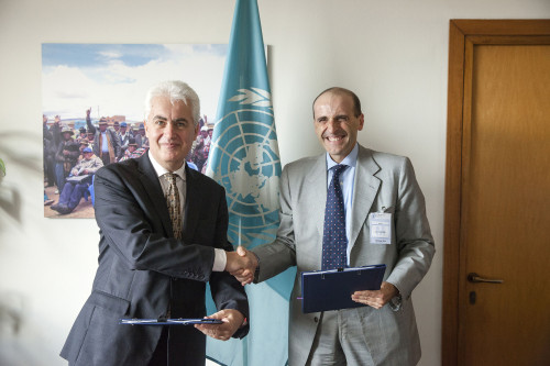 "07 October 2015, Rome, Italy - (Left to right) aurent Thomas, Assistant Director-General, (TCDD) Technical cooperation FAO, Mr. Alberto Vacchi CEO I.M.A. S.p.a. (Industria Macchine Automatiche). Signing ceremony between FAO and IMA SpA for partnership agreement on project: ""Improving food packaging for Small and Medium Agro-Enterprises in Sub-Saharan Africa"", FAO headquarters."